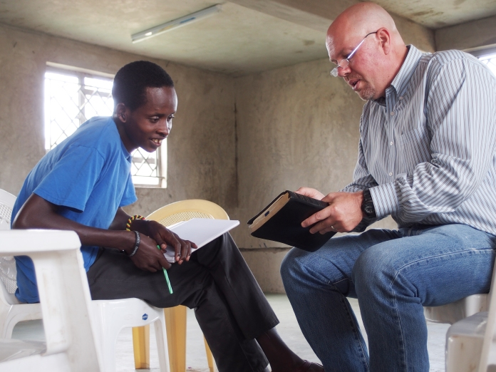 Ed works with Jackson Keringot, a Shepherd's School student, on sermon preparation.